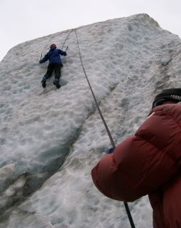Belayer and someone ice climbing